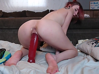 Beauty riding large sextoy